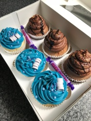 Customised gift for HIM. Chocolate sponge with chocolate buttercream. And Vanilla sponge with Caramel flavoured Buttercream, made blue to suit his favourite colour, topped with matching sweets.